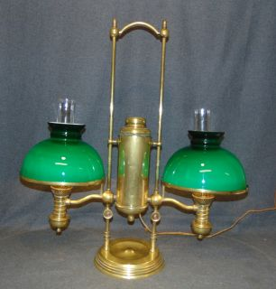 "Manhattan Brass Co. Double Student Lamp Manhattan Brass Co. Double Student Lamp. Works great. Measures 29"" tall x 27"" wide. Overall condition is good. Wear consistent with age and use. Cord & Plug work but need to be replaced. Shades are not original. Several Shipping Options Available. Starting Bid $800. Auction Estimate $900 - $1,200."