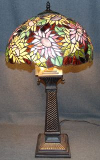 """Tiffany Style Stained Glass Table Lamp Tiffany Style Stained Glass Table Lamp. Measures 30"""" tall x 16"""" wide. Condition is very good with minimal wear. No damage. Several Shipping Options Available. Starting Bid $100. Auction Estimate $120 - $200."""
