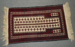 """Semi-Antique Baluch Prayer Rug Beautiful Vintage Baluch Prayer Rug. Measures 53"""" x 34"""". Condition is good minimal wear. No Damage. Several Shipping Options Available. Starting Bid $50. Auction Estimate $60 - $100."""