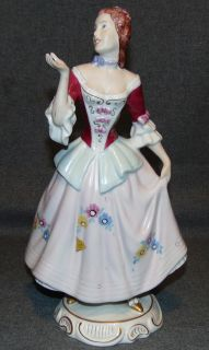 """Royal Dux Figure by Elly Strobach Konig Lovely Royal Dux porcelain figure by Elly Strobach König (Czechoslovakia 1908-2002). Measures 12-3/3"""" tall. Condition is very good with minimal wear. No damage. Bottom is marked. Several Shipping Options Available. Starting Bid $50. Auction Estimate $50 - $60."""