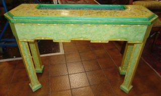 """Vintage Console Planter Table Joan McMurray Rare, Custom Made Console Planter Table by artist Joan McMurray. Circa 1978. Artist Signed. Vibrant yellow and light green planters table on rollers. Measures 31"""" tall x 43"""" wide x 14"""" deep. Overall condition is good. Wear consistent with age and use. Several Shipping Options Available. Starting Bid $200. Auction Estimate $220 - $300."""