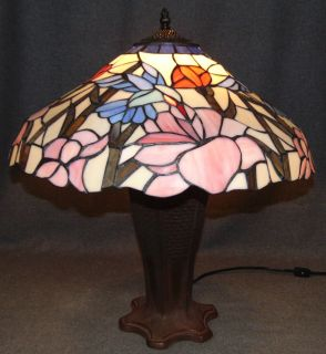"Tiffany Style Stained Glass Table Lamp Hummingbirds Tiffany Style Stained Glass Table Lamp with Hummingbirds. Measures 23"" tall x 21"" wide. Condition is Excellent. Like New. No Damage. Several Shipping Options Available. Starting Bid $150. Auction Estimate $160 - $200."