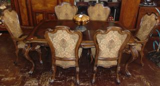 """Carved Dining Table and 6 Chairs Beautiful Carved Dining Table and 6 Chairs. 2 Captains Arm Chairs and 4 Side Chairs. Measures 30"""" tall x 80"""" wide x 48"""" deep. Also, 2 leaves are each 20"""" for a total of 120""""(10 feet). Condition is Like New. Very good. No Damage. Several Shipping Options Available. Starting Bid $800. Auction Estimate $900 - $1,200."""