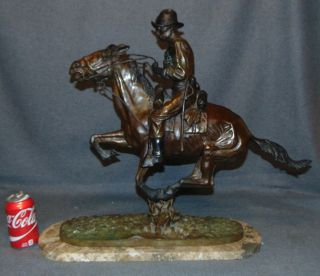 "Bronze ""Trooper of the Plains"" after Frederick Remington Bronze ""Trooper of the Plains"" Sculpture after Frederick Remington on a Granite Base. Signed. Very Heavy Piece. This Sculpture is made entirely from Bronze with a Granite Base. High Quality Bronze with excellent Detail and various shades of patina. Measures 22-1/2"" tall x 26"" wide x 8"" deep. Overall condition is Excellent. No Damage. Several Shipping Options Available. Starting Bid $400. Auction Estimate $450 - $550."