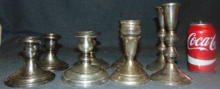Lot of 8 Sterling Silver Weighted Candleholders Lot of 8 Sterling Silver Weighted Candleholders. All are marked Sterling. As-is. Overall condition is good. Wear consistent with age and use. Several Shipping Options Available. Starting Bid $200. Auction Estimate $220 - $250.