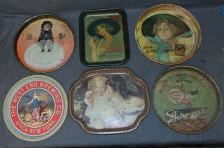 6 Vintage Tin Trays 6 Vintage Tin Trays. Overall condition is good. Wear consistent with age and use. Several Shipping Options Available. Starting Bid $70. Auction Estimate $80 - $100.