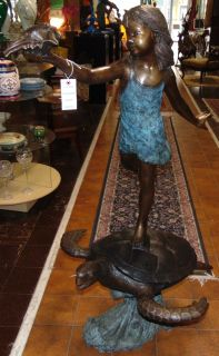 "Bronze Girl on Sea Turtle Fountain Sculpture Bronze Girl on Sea Turtle Fountain Sculpture. High Quality Bronze with excellent Detail and various shades of patina. Bronze may be used indoor or outdoor. Measures 57"" tall x 33"" wide. Condition is New, Mint. Sculpture functions as a fountain feature as well and is pre-Fitted to accept Water Pump for Fountain Feature. No Damage. Several Shipping Options Available. Starting Bid $1,800. Auction Estimate $2,000 - $2,500."