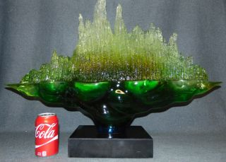 """Contemporary Acrylic Sculpture on Marble Base Beautiful Modern and Contemporary Acrylic Sculpture on a Black Marble Base. Vibrant Green tinted Acrylic on a thick Black Marble Base. Unsigned. Measures 21"""" tall x 29-1/2"""" wide. Marble base measures 2-1/2"""" tall x 10"""" wide x 7"""" deep. Condition is New, Mint. No Damage. Several Shipping Options Available. Starting Bid $750. Auction Estimate $800 - $1,000."""