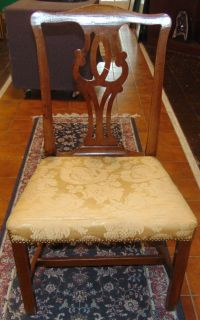 """Antique Mahogany Side Chair Lovely Antique Mahogany Side Chair. Circa early 1900's. Measures 38-1/2"""" tall x 22"""" wide x 20"""" deep. Overall condition is good with minor wear. Fabric is torn slightly. Several Shipping Options Available. Starting Bid $80. Auction Estimate $80 - $100."""