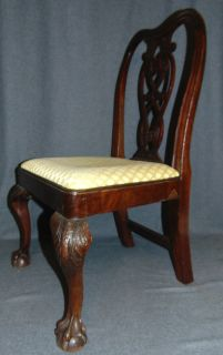 """Vintage """"Childs Size"""" Mahogany Chippendale Side Chair Vintage Childs Size Mahogany Chippendale Side Chair. Carved Mahogany with Pierced Back Splat and Claw & Ball Feet. Measures 30-1/2"""" tall x 19-1/2"""" wide x 16"""" deep. Condition is good with minimal wear and a minor previous repair (see photo close ups). Several Shipping Options Available. Starting Bid $70. Auction Estimate $80 - $100."""