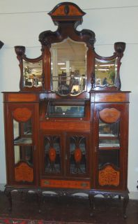 """Antique English Inlaid Mahogany Etagere Cabinet Large Antique English Inlaid Mahogany Etagere Cabinet. Measures 104"""" tall (8' 8"""") x 60"""" wide x 18-1/2"""" deep. Condition is good to fair with wear and scratches typical from age and use. Velvet fabric in display areas is tattered. Breaks down for shipping. Still a beautiful piece. Several Shipping Options Available. Starting Bid $300. Auction Estimate $400 - $500."""