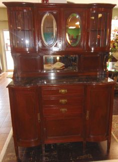 """Antique Deco Sideboard Marble Top Antique Inlaid Oak Sideboard Buffet with Marble Top. Circa 1940's. Original Beveled Glass Doors and Mirror with Display area on top. Lots of storage below on marble top base. Measures 75"""" tall x 52"""" wide x 19"""" deep. Condition is Very good. No Damage. Breaks down for easy moving. Several Shipping Options Available. Starting bid $250. Auction Estimate $300 - $350."""