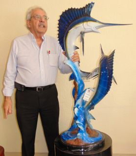 """Bronze Sailfish & Marlin Sculpture on Marble Base Large Cold-Painted Bronze Sailfish & Marlin Sculpture on a Black Marble Base. Artist signed. Measures 46"""" tall x 24"""" wide. Condition is very good with minimal wear. No damage. Several Shipping Options Available. Starting Bid $700. Auction Estimate $750 - $900."""