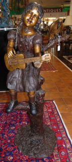 """Life Size Bronze Sculpture of a Girl with a Parrot Life Size Bronze Sculpture of a young Girl playing a Guitar with a Parrot. Excellent Detail. High Quality Bronze with excellent Detail and various shades of patina. Bronze may be used indoor or outdoor. She stands aprox 50"""" tall. Condition is excellent. No damage. This Sculpture is made entirely from Bronze. Several Shipping Options Available. Starting Bid $1,500. Auction Estimate $1,600 - $2,000."""