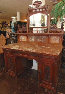 "Antique Carved Walnut Marble Top Desk with Mirror Antique Carved Walnut Marble Top Desk with Mirror. 19th Century. Measures 70"" tall x 51"" wide x 25"" deep. Condition is very good with minimal wear. No damage. Several Shipping Options Available. Starting Bid $200. Auction Estimate $250 - $300."