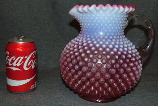 """Vintage Cranberry Hobnail Opalescent Glass Pitcher Vintage Cranberry Hobnail Opalescent Glass Pitcher. Measures 8"""" tall x 7"""" wide. Overall condition is Excellent. No Damage. Starting Bid $80. Auction Estimate $80 - $100."""