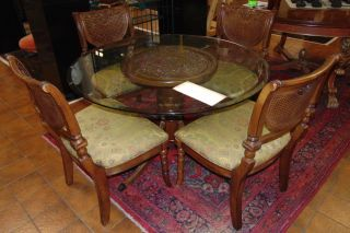 "Glass Top Table & 4 Arm Chairs Glass Top Table & 4 Arm Chairs. Round Table measures 30"" tall x 48"" wide. Overall condition is good. Wear consistent with age and use. Several Shipping Options Available. Starting Bid $300. Auction Estimate $350 - $400."