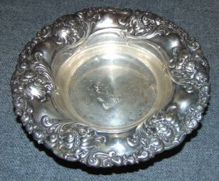 """Alvin Sterling Silver Bowl Ornate """"Alvin"""" Sterling Silver Bowl. Measures 5-3/4"""" round. Aprox 2 oz. of Sterling Silver. Condition is very good with minimal wear. Signed. No damage. Starting Bid $40. Auction Estimate $50 - $60."""