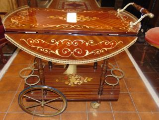 """Italian Inlaid Drop Leaf Marquetry Wood  Italian Inlaid Drop Leaf Marquetry Wood Bar Cart. Measures 31"""" tall x 32"""" wide x 17-1/2"""" deep with leaves down. Leaves open up to a 30"""" round top. Condition is very good. No Damage. Several Shipping Options Available.  Serious inquires Please contact us. Click on Picture to see additional photos."""