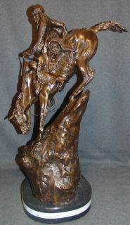 "Bronze ""Mountain Man"" Sculpture after Frederick Remington Western Bronze ""Mountain Man"" Sculpture after Frederick Remington on a Triple Marble Base. Signed. Very Heavy Piece. This Sculpture is made entirely from Bronze with a Marble Base. Measures 29-1/2"" tall. Condition is New, Mint. No Damage. Several Shipping Options Available. Serious inquires Please contact us. Click on Picture to see additional photos."