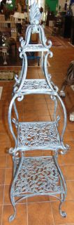 "Ornate Cast Aluminum Plant Stand Etagere'  Ornate Cast Aluminum Plant Stand Etagere'. Measures 59"" tall x 14"" wide. Condition is Like New. Very good. No Damage. Several Shipping Options Available. Starting Bid $50. Auction Estimate $150 - $250."