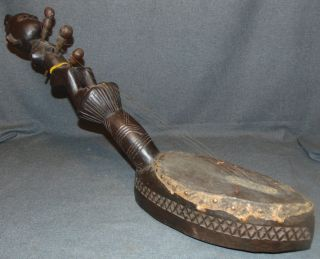 """Makonde Tribe Guitar Tanzania  Makonde Tribe Tanzanian Guitar. Authentic African Ceremonial Art. Measures 32"""" x 6"""" wide. Overall condition is good. Wear consistent with age and use. Several Shipping Options Available. Starting Bid $30. Auction Estimate $80 - $150."""