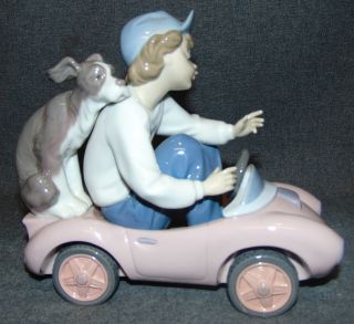 """Lladro #5770 """"Out for a Spin"""" Lladro #5770 """"Out for a Spin"""". Issued in 1991 and retired in 1994. Measures 6-3/4"""" long x 8"""" wide. Condition is Mint. No Damage. Properly marked on bottom. Several Shipping Options Available. Starting Bid $50. Auction Estimate $150 - $250."""