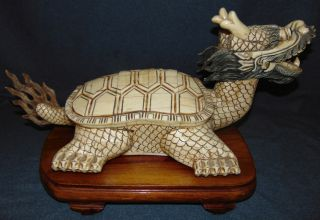 "Feng Shui ""Dragon Turtle"" Sculpture Bone Feng Shui Dragon Turtle Sculpture on a Carved Wood Base. Measures 13"" tall x 23"" wide x 12"" deep. Overall condition is good with some losses and repairs (see photo close-ups). Several Shipping Options Available. Starting Bid $50. Auction Estimate $80 - $200."