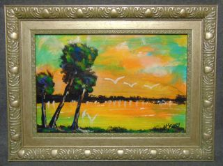 """Original Florida Highwayman Painting by Michael Sears Original, modern-day Florida Highwayman painting by contemporary artist, Micheal Sears. Large Oil on Masonite. Nicely framed. Artist Signed. Measures 18"""" tall x 24"""" wide. Condition is very good. No Damage. Michael Sears (1962- present) is 2nd generation trained by George Buckner Jr. Original member, and personally influenced by the several other members of this art movement with whom he interacted. He remains true to Highwaymen subject, style, materials and outdoor selling methods.  Several Shipping Options Available. Starting Bid $50. Auction Estimate $100 - $150."""