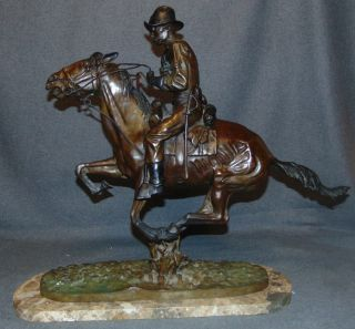 "Bronze ""Trooper of the Plains"" after Frederick Remington Bronze ""Trooper of the Plains"" Sculpture after Frederick Remington on a Granite Base. Signed. Very Heavy Piece. This Sculpture is made entirely from Bronze with a Granite Base. High Quality Bronze with excellent Detail and various shades of patina. Measures 22-1/2"" tall x 26"" wide x 8"" deep. Overall condition is Excellent. No Damage. Several Shipping Options Available. Starting Bid $50. Auction Estimate $450 - $550."