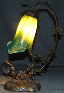 """Figural Fairy Lamp with Art Glass Shade Fairy Lamp with Art Glass Shade. Measures 14-1/2"""" tall. Overall condition is Excellent. No Damage. Several Shipping Options Available. Starting Bid $50. Auction Estimate $100 - $150."""