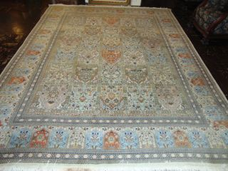 "Large Persian Rug 12' x 9' 4"" Large Persian Rug. Signed. Measures 12' x 9'4"". Condition is very good with minimal wear. Some stains. 100 % wool. No damage. Several Shipping Options Available. Starting Bid $50. Auction Estimate $600 - $750."