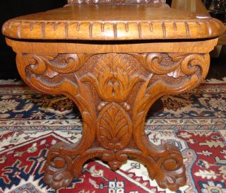 """Antique Carved Oak Sgabello Chair  Antique Carved Oak Sgabello Chair. Measures 42-1/2"""" tall x 18"""" wide x 22"""" deep. Condition is very good with minimal wear. 1 small chip on back side (see close-up photo). Several Shipping Options Available. Starting Bid $50. Auction Estimate $200 - $300."""