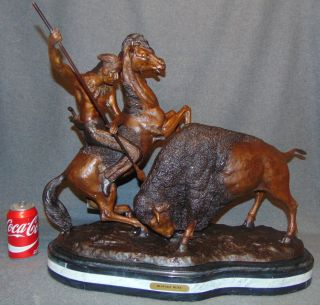 "Bronze Charles Russell Western Sculpture Bronze Western Sculpture of a Buffalo and a Native American on a Triple Marble Base after ""Charles M. Russell"" (American, 1864-1926). Signed. Measures 24"" long x 21"" tall x 12"" deep. Condition is New, Mint. No Damage. This Sculpture is made entirely from Bronze with a Marble Base. Several Shipping Options Available. Starting Bid $50. Auction Estimate $750 - $900."