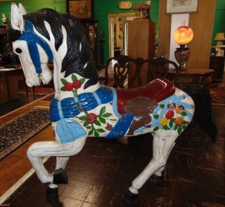 "Marcus Charles Illions Carved Carousel Horse Marcus Charles Illions Carved Carousel Horse. Middle row stander. Circa 1900. Condition is very good with paint losses typical. No damage. Stands 60"" tall x 60"" long. Several Shipping Options Available. Serious inquires Please contact us. Click on Picture to see additional photos."