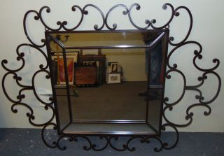 "Decorative Wrought Iron Wall Mirror Decorative and Heavy, Wrought Iron Wall Mirror. Nice Scroll Work. Can hang either way. Measures 66"" x 47"". Overall condition is very good. Several Shipping Options Available. Starting Bid $50. Auction Estimate $80 - $100."