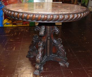 """Antique Carved Walnut & Marble Top Table Antique Carved Walnut & Marble Top Table. Measures 24"""" tall x 30"""" wide. Condition is very good with minimal wear. No damage. Several Shipping Options Available. Starting Bid $50. Auction Estimate $300 - $500."""