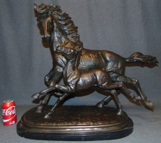 """Bronze Horses on Marble Sculpture Bronze Horses Sculpture on a Black Marble Base. Beautiful Mare and Fold running side by side. Large and Heavy Sculpture. Measures 24"""" tall x 30"""" wide. This Sculpture is made entirely from Bronze with a Marble Base. Condition is New, Mint. No Damage. Several Shipping Options Available. Starting Bid $50. Auction Estimate $400 - $550."""