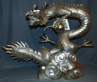 """Silvered Bronze Dragon & Sphere Fountain Sculpture Large and Awesome, Asian Style Dragon & Sphere or """"Pearl"""", Bronze Fountain Sculpture with """"Silvered"""" Patina. High Quality with excellent detail. Weighs aprox 50lbs. Stands 34"""" wide x 27"""" tall. Sculpture functions as a fountain feature as well. Condition is New. Excellent. No damage at all. This Sculpture is made entirely from Bronze. Several Shipping Options Available. Starting bid $50. Auction Estimate $550 - $700."""