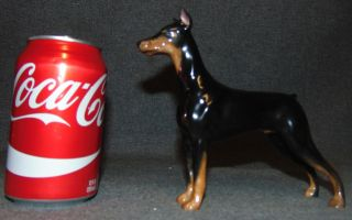 """Royal Doulton Champion Rancho Dobe's Storm Doberman Pinscher Royal Doulton Champion Rancho Dobe's Storm Doberman Pinscher Dog Figurine. HN 2645. Measures 6"""" tall x 7"""" wide. Bottom is marked. Overall condition is Excellent. No Damage. Several Shipping Options Available. Starting Bid $40. Auction Estimate $50 - $80."""