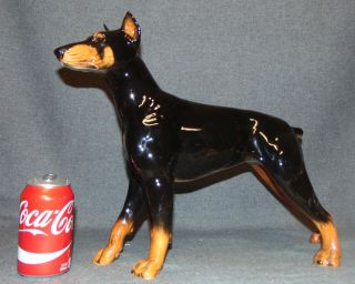 "Large Goebel Porcelain Doberman Pinscher Dog Figurine Large Goebel Porcelain Doberman Pinscher Dog Figurine. Measures 14"" tall x 18"" wide. Bottom is marked. Overall condition is Excellent. No Damage. Several Shipping Options Available. Starting Bid $50. Auction Estimate $70 - $150."