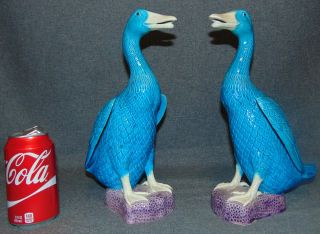 """Set of 2 Porcelain Ducks Set of 2 Porcelain Ducks. Each stands 12"""" tall. Condition is good with one exception. A tiny chip on neck of one duck (see close-up photos). Bottoms are marked. Several Shipping Options Available. Starting Bid $30. Auction Estimate $50 - $60."""