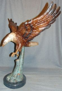"""Bronze American Bald Eagle  Cold-painted Bronze American Bald Eagle Sculpture on a Black Marble Base. He measures 30"""" tall x 27"""" wide. Condition is New, Mint. No Damage. This Sculpture is made entirely from Bronze with a Marble Base. Several Shipping Options Available. Starting Bid $50. Auction Estimate $750 - $900."""