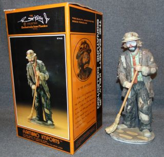 "Emmett Kelly Jr Clown ""In the Spotlight""  Flambro Emmett Kelly Jr Porcelain Clown ""In the Spotlight"" Figurine. #9745. Includes original box. Measures 10-1/4"" tall. Condition is very good. No Damage. Starting Bid $30. Auction Estimate $50 - $80."