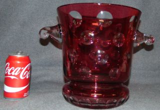 """Ruby Red European Cut Crystal Champagne Bucket Ruby Red European Cut Crystal Champagne or Ice Bucket. Heavy and Thick Lead Crystal. Measures 10"""" tall x 12"""" wide at the handles. Condition is New, Mint. No Damage. Several Shipping Options Available. Starting Bid $50. Auction Estimate $120 - $200."""