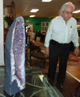"""Large Amethyst Geode Cathedral  Large Brazilian Amethyst Crystal Geode Cathedral. Measures 32"""" tall. Overall condition is Excellent. No Damage. Several Shipping Options Available. Starting Bid $100. Auction Estimate $900 - $1,200."""