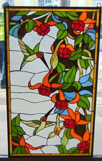 """Custom Stained Glass Hanging Panel with Hummingbirds Custom Stained Glass Hanging Panel with Hummingbirds. High Quality. Measures 34-1/2"""" tall x 20-1/2"""" wide. Condition is New, Mint. No Damage. Several Shipping Options Available. Starting Bid $50. Auction Estimate $120 - $150."""