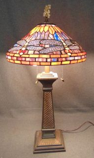 "Tiffany Style Stained Glass Dragonfly Table Lamp Tiffany Style Stained Glass Dragonfly Table Lamp. Measures 32"" tall x 17"" wide. Condition is very good with minimal wear. No damage. Several Shipping Options Available. Starting Bid $30. Auction Estimate $80 - $150."