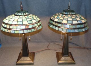 "Pair (2) of Tiffany Style Stained Glass Table Lamps Pair (2) of Tiffany Style Stained Glass Table Lamps. Each measures 26"" tall x 16"" wide. Condition is very good with minimal wear. No damage. Several Shipping Options Available. Starting Bid $50 for both. Auction Estimate $250 - $350."