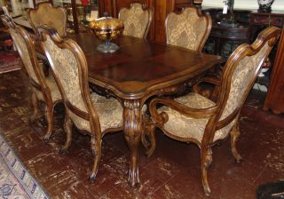 "Carved Dining Table and 6 Chairs Beautiful Carved Dining Table and 6 Chairs. 2 Captains Arm Chairs and 4 Side Chairs. Measures 30"" tall x 80"" wide x 48"" deep. Also, 2 leaves are each 20"" for a total of 120""(10 feet). Condition is Like New. Very good. No Damage. Several Shipping Options Available. Starting Bid $50. Auction Estimate $750 - $1,000."